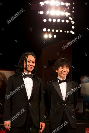 Actors Tatsuya Nakamura, left, and Yusaku Mori pose for photographers as they arrive for the screening of Nobi (Fires on the Plain) at the 71st edition of the Venice Film Festival in Venice, Italy
