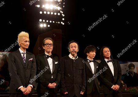 From left, composer Chu Ishikawa, actor Lily Franky, director Shinya Tsukamoto, actor Yusaku Mori and actor Tatsuya Nakamura pose for photographers as they arrive for the screening of Nobi (Fires on the Plain) at the 71st edition of the Venice Film Festival in Venice, Italy