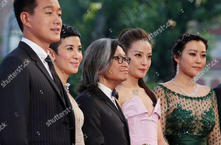 The cast of Dearest, from left, actor Tong Dawei, actress Sandra Ng director Peter Ho-Sun Chan, actress Zhao Wei, actress Hao Lei, pose for photographers as they arrive for the screening of Birdman during the opening for the 71st edition of the Venice Film Festival in Venice, Italy