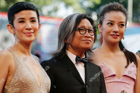 Stock Picture of The cast of Dearest, from left, actress Sandra Ng, director Peter Ho-Sun Chan, and actress Zhao Wei pose for photographers as they arrive for the screening of Birdman during the opening for the 71st edition of the Venice Film Festival in Venice, Italy