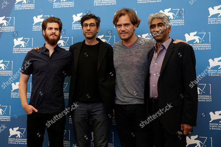 Andrew Garfield, Ramin Bahrani, Michael Shannon, Ashok Amritraj From left, actor Andrew Garfield, director Ramin Bahrani, actor Michael Shannon and producer Ashok Amritraj pose for photographers during during the photo call for the movie 99 Homes during the 71st edition of the Venice Film Festival in Venice, Italy