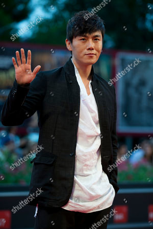 Actor Qin Hao arrives for the screening of the movie Red Amnesia, at the 71st edition of the Venice Film Festival in Venice, Italy
