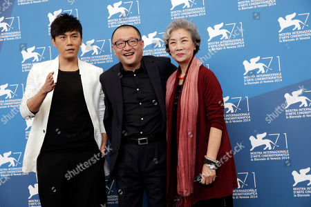 Qin Hao Wang Xiaoshuai Lu Zhong From left, actor Qin Hao, director Wang Xiaoshuai and actress Lu Zhong pose during the photo call for the movie Red Amnesia, at the 71st edition of the Venice Film Festival in Venice, Italy