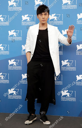 Qin Hao Actor Qin Hao poses during the photo call for the movie Red Amnesia, at the 71st edition of the Venice Film Festival in Venice, Italy