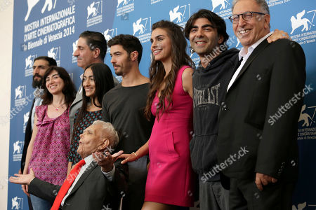 Stock Picture of Alexander Hacke, Nuhran Sekerci, Simon Abkarian, Hindi Zahra, Tahar Rahim, Lara Heller, Fatih Akin, Makram Khoury, Mardik Martin From left, composer Alexander Hacke, producer Nuhran Sekerci, actors Simon Abkarian, Hindi Zahra, Tahar Rahim, Lara Heller, Director Fatih Akin, actor Makram Khoury, and screenwriter Mardik Martin, seated, pose during the photo call for the movie The Cut at the 71st edition of the Venice Film Festival in Venice, Italy