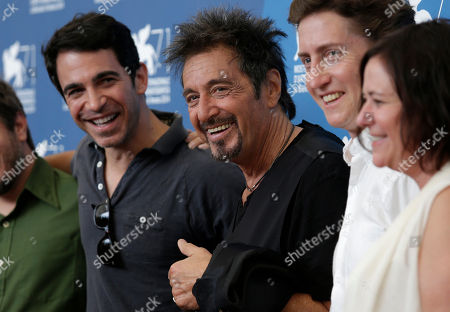 From left, actor Chris Messina, actor Al Pacino, director David Gordon Green and producer Lisa Muskat pose for photographers during a photo call for the movie The Humbling during the 71st edition of the Venice Film Festival in Venice, Italy