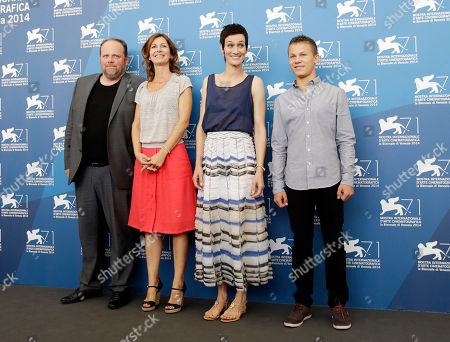 From left, actor Gregory Gadebois, director Alix Delaporte and actors Clotilde Hesme and Romain Paul pose during the photo call for the movie The Last Hammer Blow, at the 71st edition of the Venice Film Festival in Venice, Italy