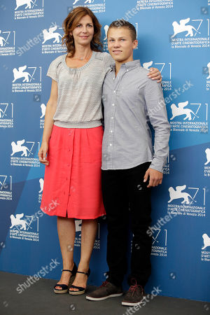 Director Alix Delaporte, left, and actor Romain Paul pose during the photo call for the movie The Last Hammer Blow, at the 71st edition of the Venice Film Festival in Venice, Italy