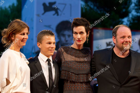 From left, director Alix Delaporte, actor Romain Paul, Clotilde Hesme, and Gregory Gadebois pose for photographers as they arrive for the screening of The Last Hammer Blow at the 71st edition of the Venice Film Festival in Venice, Italy