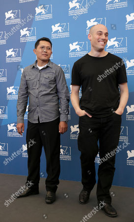 Actor Adi Rukun and director Joshua Oppenheimer pose for photographers at the photo call for the film The Look of Silence the 71st edition of the Venice Film Festival in Venice, Italy