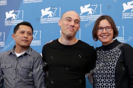 Actor Adi Rukun, director Joshua Oppenheimer and producer Signe Byrge pose for photographers at the photo call for the film The Look of Silence the 71st edition of the Venice Film Festival in Venice, Italy