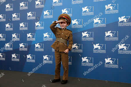 Actor Dachi Orvelashvili poses for photographers during a photo call for The President during the 71st edition of the Venice Film Festival in Venice, Italy