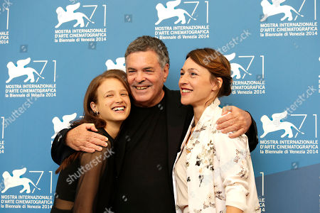 Meshi Olinski, Sarah Adler, Amos Gitai Actresses Meshi Olinski, left, and Sarah Adler, right, are embraced by director Amos Gitai, centre, as they pose during the photo call for the movie Tsili during the 71st edition of the Venice Film Festival in Venice, Italy