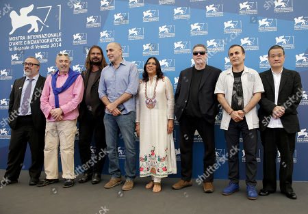 Stock Photo of Alex de la Iglesia, Hector Babenco, Warwick Thornton, Guillermo Arriaga, Mira Nair, Amos Gitai, Bahman Ghobadi, Hideo Nakata Directors Alex de la Iglesia, Hector Babenco, Warwick Thornton, Guillermo Arriaga, Mira Nair, Amos Gitai, Bahman Ghobadi and Hideo Nakata pose during the photo call for the movie 'Words with the gods' at the 71st edition of the Venice Film Festival in Venice, Italy