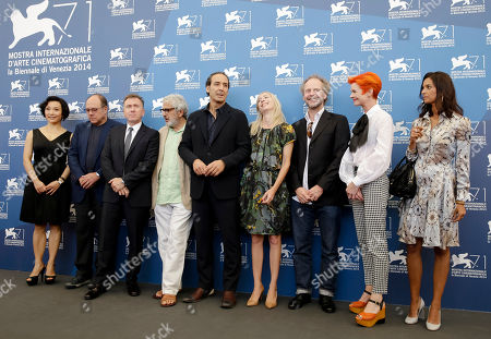 Joan Chen, Carlo Verdone,Tim Roth, Elia Suleiman, Alexandre Desplat, Jessica Hausner, Philip Groning, Sandy Powell, Jhumpa Lahiri Memebers of the jury of the Venice 71st Film Festival, from left, Joan Chen, Carlo Verdone,Tim Roth, Elia Suleiman, President Alexandre Desplat, Jessica Hausner, Philip Groning, Sandy Powell, Jhumpa Lahiri pose during a photo call in Venice, Italy, . The 71st edition of the Venice Film Festival starts Wednesday, Aug. 27, and ends on Sept. 6