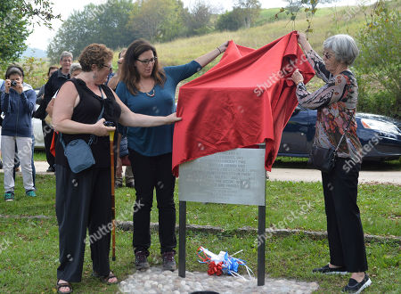 "Stock Photo of Frome left, Deanne Ifhin-Batterman, her sister Faye McBride, daughter of Isidore Ifshin a crew member who survived the crash, and Barbara Nash, the daughter of pilot Earl Remmel, unveil a memorial plaque bearing the pilots' names during a ceremony to honor the memory two Americans at the controls of a B-25 Mitchell dubbed ""Maybe"" damaged during a bombing run near Trento during World War II, nearly 70 years after they died in the crash, at the crash site, near Santa Barbara, Italy, . Pilot Earl Remmel of Hooker, Oklahoma, and co-pilot Leslie Speer of Jeffersontown, Kentucky, kept the plane steady long enough for the other five crew members to bail out. The plane crashed into a mountain moments later"