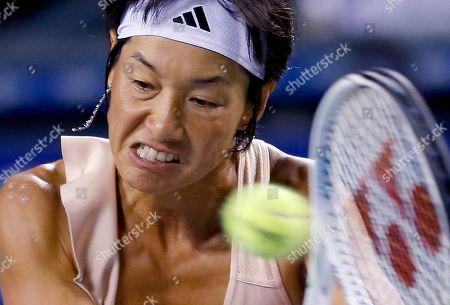 Kimiko Date-Krumm Kimiko Date-Krumm of Japan returns a shot to Victoria Azarenka of Belarus during their first round match of the Japan Pan Pacific Open tennis tournament in Tokyo