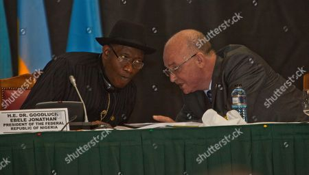 Stock Photo of President of the Federal Republic of Nigeria, Dr. Goodluck Ebele Jonathan, left, with Ambassador Smail Chergui, Comissioner Peace and Security African Union Commission, right, during the AU Summit, in Nairobi, Kenya. A one-day African Union Peace and Security Summit started in Nairobi, Kenya, Tuesday