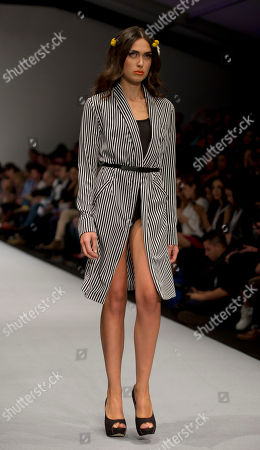A model wears a creation from Black, designed by Mexican singer Leonardo de Lozanne, during Fashion Week in Mexico City
