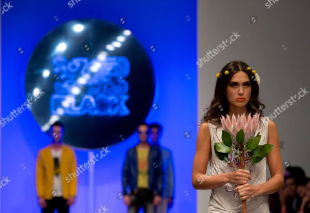Models walk the runway in clothes by Black, designed by Mexican singer Leonardo de Lozanne, during Fashion Week in Mexico City