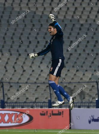 Stock Image of Al Ahly goalkeeper Sherif Ekramy celebrates saving the last penalty kick to win the Egyptian Super Cup soccer match against Zamalek at the Cairo International Stadium in Cairo, Egypt, . The Egyptian football association (EFA) said that fans of Al Ahly and Zamalek clubs will not be allowed to attend the match.The Egyptian football association (EFA) said that fans of Al Ahly and Zamalek clubs will not be allowed to attend the match. Egyptian authorities are limiting the number of soccer fans after the past three years of riots in stadiums