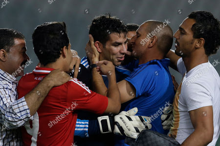 Sherif Ekramy Al Ahly goalkeeper Sherif Ekramy, center, celebrates with his teammates saving the last penalty kick to win the Egyptian Super Cup soccer match against Zamalek at the Cairo International Stadium in Cairo, Egypt, Sunday Sept. 14, 2014. The Egyptian football association (EFA) said that fans of Al Ahly and Zamalek clubs will not be allowed to attend the match. Egyptian authorities are limiting the number of soccer fans after the past three years of riots in stadiums