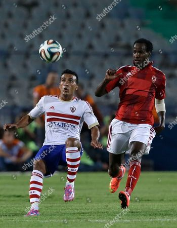 Sallah Aldeen Al Thyoubi, Mohamed Abdel-Shafy Al Ahly's Sallah Aldeen Al Thyoubi, right, and Zamalek's Mohamed Abdel-Shafy vie for the ball during their Egyptian Super Cup soccer match at the Cairo International Stadium in Cairo, Egypt, Sunday, Sept. 14, 2014. Egyptian authorities are limiting the number of soccer fans after the past three years of riots in stadiums