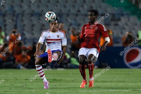Al Ahly's Sallah Aldeen Al Thyoubi, right, and Zamalek's Mohamed Abdel-Shafy vie for the ball during their Egyptian Super Cup soccer match at the Cairo International Stadium in Cairo, Egypt, . Egyptian authorities are limiting the number of soccer fans after the past three years of riots in stadiums