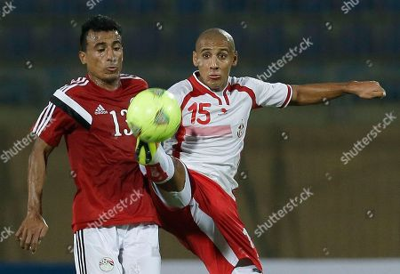 Tunisia's Wahbi Khazri, right, controls the ball past Egypt's Mohamed Abdel Shafy during their Africa Cup of Nations group G qualifying soccer match in Cairo, Egypt, . The two other teams in group G are Senegal and Botswana