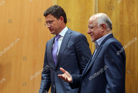 Bijan Zanganeh, Alexander Novak Russian Energy Minister Alexander Novak, left, and Iranian Oil Minister Bijan Zanganeh leave after a joint meeting in Tehran, Iran, . Russian officials have traveled to Iran's capital to boost economic ties between the two countries. Zanganeh and Novak oversaw a meeting Tuesday of businessmen in Tehran, calling on them to increase trade