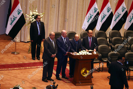 Vice presidents Nouri al-Maliki, center right, Midhat al-Mahmoud Iraq's Supreme Court top judge, 2nd right, Osama al-Nujaifi, 3rd right, Ayad Allawi, center left, are seen during a swearing in ceremony in Baghdad, Iraq, . Iraq's parliament officially named Haider al-Abadi the country's new prime minister late Monday and approved most of the candidates put forward for his Cabinet amid mounting pressure to form an inclusive government that can collectively cap the advance of Sunni militants