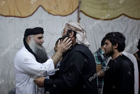 Abu Qatada Radical al-Qaida-linked preacher Abu Qatada, first left, receives a friend, on the day he was released from Jordanian prison after an acquittal on security charges, in Amman, Jordan. Abu Qatada and Abu Mohammed al-Maqdisi, two of Jordan's top pro-al-Qaida ideologues held court on the rooftop of a villa whispering to each other and rising occasionally from plastic chairs to greet supporters. The two have denounced some of the Islamic State group's practices as un-Islamic - comments some analysts say have turned the preachers into assets in Jordan's campaign to contain the Islamic State, which is believed to have attracted thousands of followers in Jordan