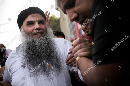 "Family and friends of radical al-Qaida-linked preacher Abu Qatada, left, greet him as he arrives to his family's home in Amman, Jordan, . A Jordanian court on Wednesday acquitted Qatada - known for his fiery pro-al-Qaida speeches - of involvement in a plot to target Israeli and American tourists and Western diplomats in Jordan more than a decade ago. The three-judge panel unanimously acquitted Qatada ""because of the lack of convincing charges against him,"" said Judge Ahmed Qattarneh"