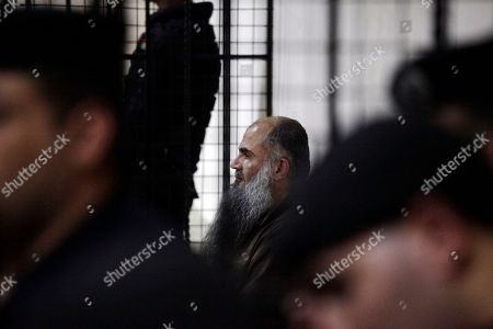 "Abu Qatada Radical al-Qaida-linked preacher Abu Qatada, center, listens during his verdict session at a Jordanian court in Amman, . A Jordanian court on Wednesday acquitted Qatada - known for his fiery pro-al-Qaida speeches - of involvement in a plot to target Israeli and American tourists and Western diplomats in Jordan more than a decade ago. The three-judge panel unanimously acquitted Qatada ""because of the lack of convincing charges against him,"" said Judge Ahmed Qattarneh"
