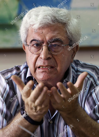 """Stock Image of Elias Khoury Lebanese prominent writer and intellectual Elias Khoury speaks during an interview with The Associated Press at his office in the Institute for Palestine Studies in Beirut, Lebanon. Khoury, one of Lebanon's best known novelists, was born in 1948, the year of the """"nakba,"""" or catastrophe, as Palestinians and other Arabs describe Israel's creation. He has lived enough wars and revolutions to know that the current turmoil is one of the most dangerous periods that the turbulent region has seen"""