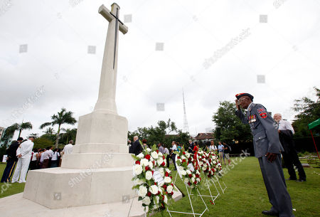"Myanmar World War II veteran David Daniel salutes as he lays flowers during a ceremony to mark the 70th anniversary of the end of the World War II in the east, at Hanthawaddy War Cemetery in Yangon, Myanmar. A group of World War II veterans from Myanmar's ethnic Karen minority, most in their 90s, prayed and sang a poignant hymn Saturday at the graveside of a legendary British officer who sacrificed his life for an ethnic group for whom the war's end 70 years ago led to the world's longest-running insurgency. The gathering of the old warriors at the grave of Maj. Hugh Paul Seagrim - who the Karen call ""Grandfather Longlegs"" - was part of a ceremony to mark Victory over Japan Day, which ended the global conflict and savage combat that devastated Burma, as the country was then known"