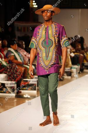 A model displays an outfit by designer Charles Anthony, during the Economic Community of West Africa state fashion week in Lagos, Nigeria