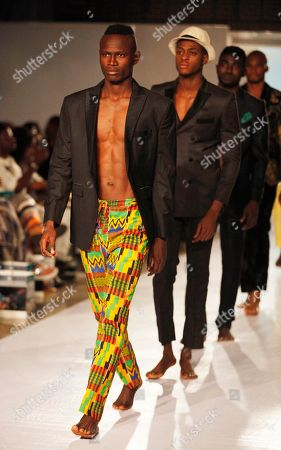 Models display outfits by designer Charles Anthony, during the Economic Community of West Africa state fashion week in Lagos, Nigeria