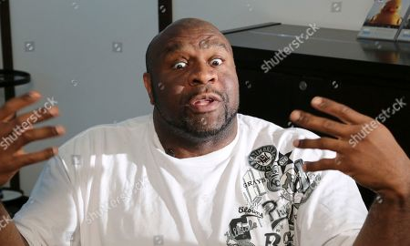 """Bob Sapp Former NFL player Bob """"The Beast"""" Sapp speaks during an interview in Tokyo. Sapp, a 6-foot-5, 350-pound tank of a man who played briefly as a lineman with the Chicago Bears and Minnesota Vikings, will be topping the bill at a martial arts extravaganza in Pyongyang later this month. The two-day event is being staged by Japanese pro-wrestler-turned-politician Kanji """"Antonio"""" Inoki in an oddball attempt at sports diplomacy just as relations between North Korea and Japan are beginning to thaw. """"This is the No. 1 unusual and a little bit crazy thing (I've ever done),"""" Sapp said of his upcoming trip"""