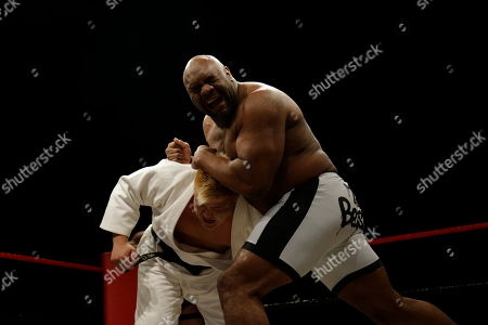"""Bob """"The Beast"""" Sapp wrestles his opponent during a pro wrestling exhibition, in Pyongyang, North Korea. North Koreans got their first look at pro wrestling in about 20 years on Saturday when a former NFL lineman and 20 other fighters from around the world took to the ring for an exhibition in Pyongyang put together by a colourful Japanese pro-wrestler who is now a member of parliament"""