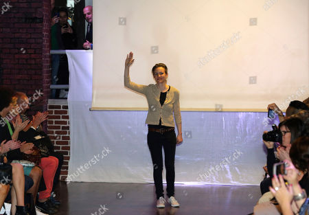 Stock Picture of British fashion designer Corrie Nielsen waves after the presentation of her ready-to-wear Spring/Summer 2015 collection presented in Paris, France
