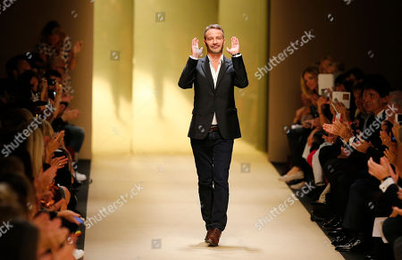 French-Swedish fashion designer Marcel Marongiu acknowledges applause after the presentation of Guy Laroche Spring-Summer 2015 ready-to-wear collection, in Paris, France
