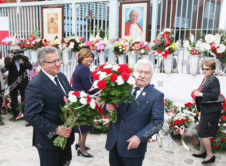 Bronislaw Komorowski,Lech Walesa Poland's President Bronislaw Komorowski, left, and former president, and first Solidarity leader Lech Walesa preparing to lay flowers at the historic gate of the Gdansk shipyard during anniversary ceremonies in Gdansk, Poland on . Second from left is First Lady Anna Komorowska, first from right is Walesa's wife, Danuta. Solidarity was born in August 1980 out of worker protests in Gdansk shipyard and soon became a nationwide freedom movement. In 1989 it peacefully toppled Poland's communist rulers, paving the way for similar change in other Soviet bloc nations