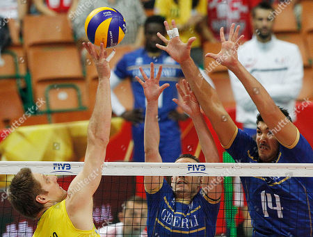 Nicolas Le Goff, Benjamin Toniutti, Eder Carbonera France's Nicolas Le Goff, right, and Benjamin Toniutti challenge for the ball with Eder Carbonera of Brazil during the first semifinal match between France and Brazil of the FIVB Volleyball Men's World Championship Poland 2014 in Katowice, Poland