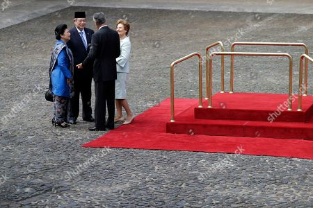 Susilo Bambang Yudhoyono, Anibal Cavaco Silva, Ani Bambang Yudhoyono, Maria Cavaco Silva Indonesia's President Susilo Bambang Yudhoyono, second left, and his wife Ani Bambang Yudhoyono, left, are welcomed by the Portuguese President Anibal Cavaco Silva, second right, and his wife Maria Cavaco Silva, right, at the Belem presidential palace, in Lisbon, . The one day state visit of Yudhoyono was the first that an Indonesian President paid to Portugal since 1960. Bilateral relations between the two countries were severed during years after Indonesia annexed in 1975 East Timor, a former Portuguese colony