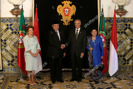 Susilo Bambang Yudhoyono, Anibal Cavaco Silva, Ani Bambang Yudhoyono, Maria Cavaco Silva Indonesia's President Susilo Bambang Yudhoyono, second left, and his wife Ani Bambang Yudhoyono, right, pose for the media with Portuguese President Anibal Cavaco Silva, second right, and his wife Maria Cavaco Silva, left, at the Belem presidential palace, in Lisbon, . The one day state visit of Yudhoyono was the first that an Indonesian President paid to Portugal since 1960. Bilateral relations between the two countries were severed during years after Indonesia annexed in 1975 East Timor, a former Portuguese colony