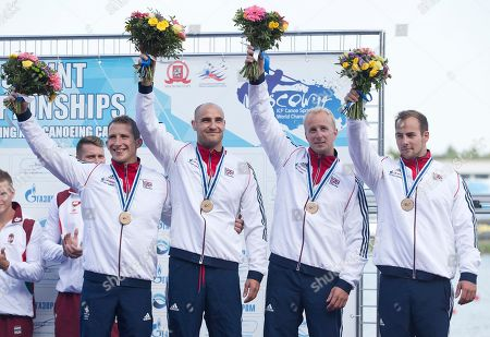 Edward Mckeever, Liam Heath, Jonathan Schofield, Kristian Reeves Bronze medallists from left, Britain's Edward Mckeever, Liam Heath, Jonathan Schofield and Kristian Reeves celebrate on the podium after the K1 relay men 200m final of the ICF Canoe Sprint World Championships 2014 in Moscow, Russia