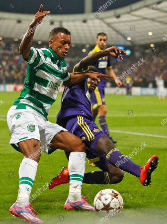 Shikabala, Sintayehu Sallalich Sporting's Shikabala, left, fights for the ball with Maribor's Sintayehu Sallalich during the Champions League Group G soccer match between Maribor and Sporting, in Maribor, Slovenia