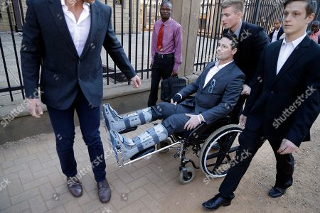 Oscar Pistorius Oscar Pistorius' brother Carl Pistorius, on a wheel chair, with relatives arrives at the high court in Pretoria, South Africa, . Presiding Judge Thokozile Masipa is expected to announce her verdict in Pistorius' murder trail after scrutinizing evidence Thursday and Friday given by 37 witnesses in a court transcript running to thousands of pages in a drama that has played out over six months