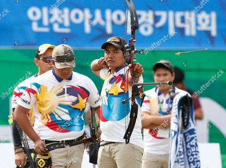 Paul Marton Dela Cruz, Ian Patrick Chipeco, Earl Benjamin Yap From left, members of the Philippines Paul Marton Dela Cruz, Ian Patrick Chipeco and Earl Benjamin Yap compete at the compound men's team archery match at the 17th Asian Games in Incheon, South Korea